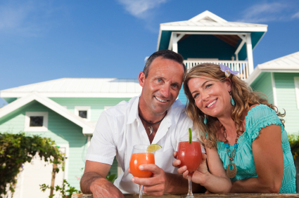 Smiling adult couple holding drinks